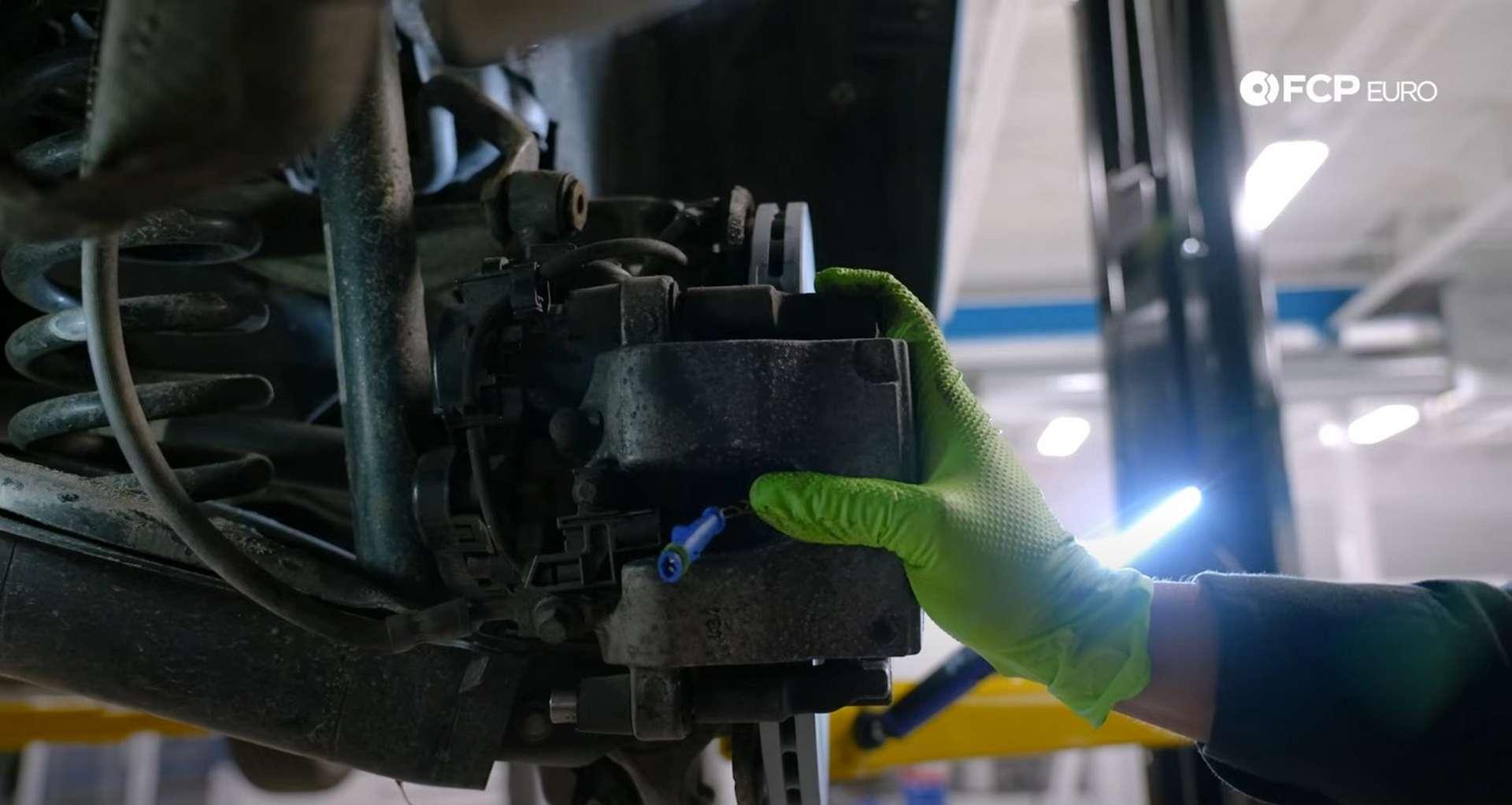 DIY Mercedes W205 Rear Brake Service refitting the caliper