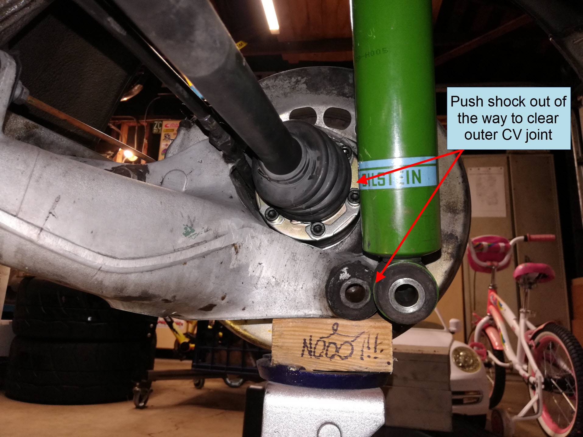 Air-cooled Porsche 911 outer CV joint installation with shock clearance.