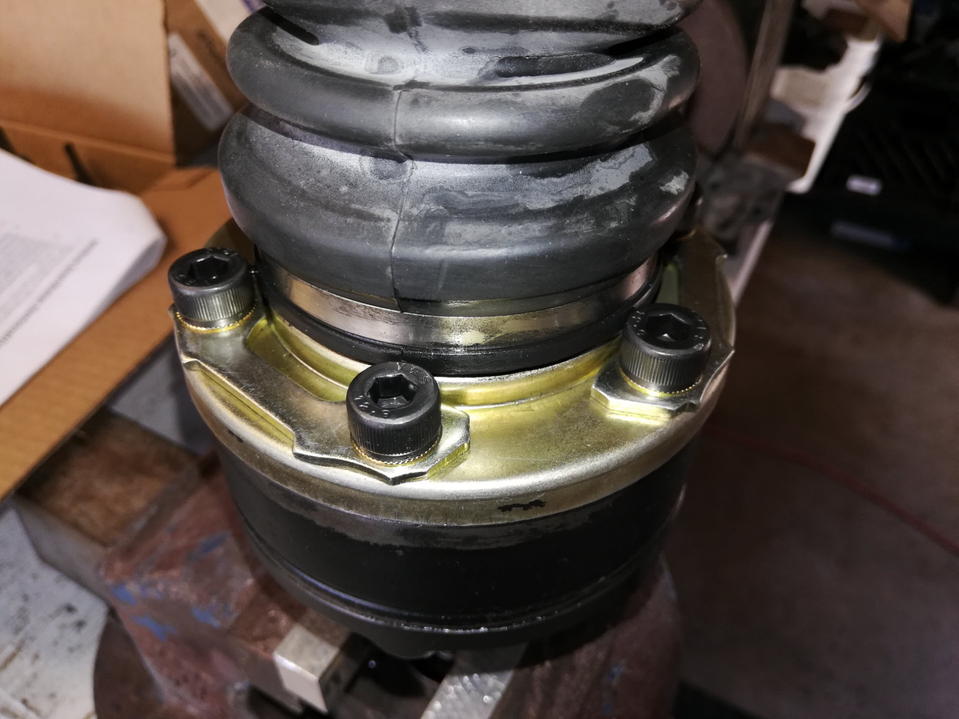 Air-cooled Porsche 911 outer CV joint and stub axle assembly on vise.