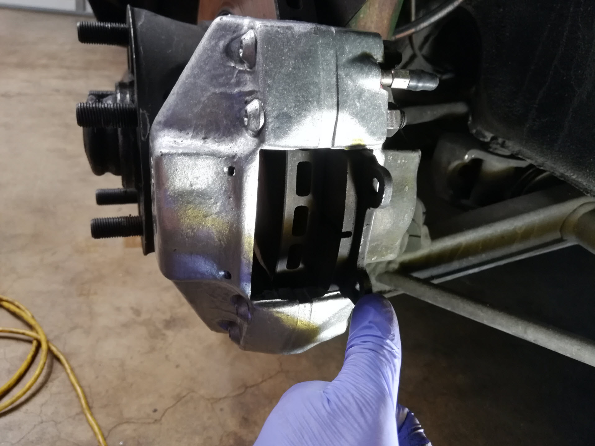 Air-cooled Porsche 911 brake caliper installation.