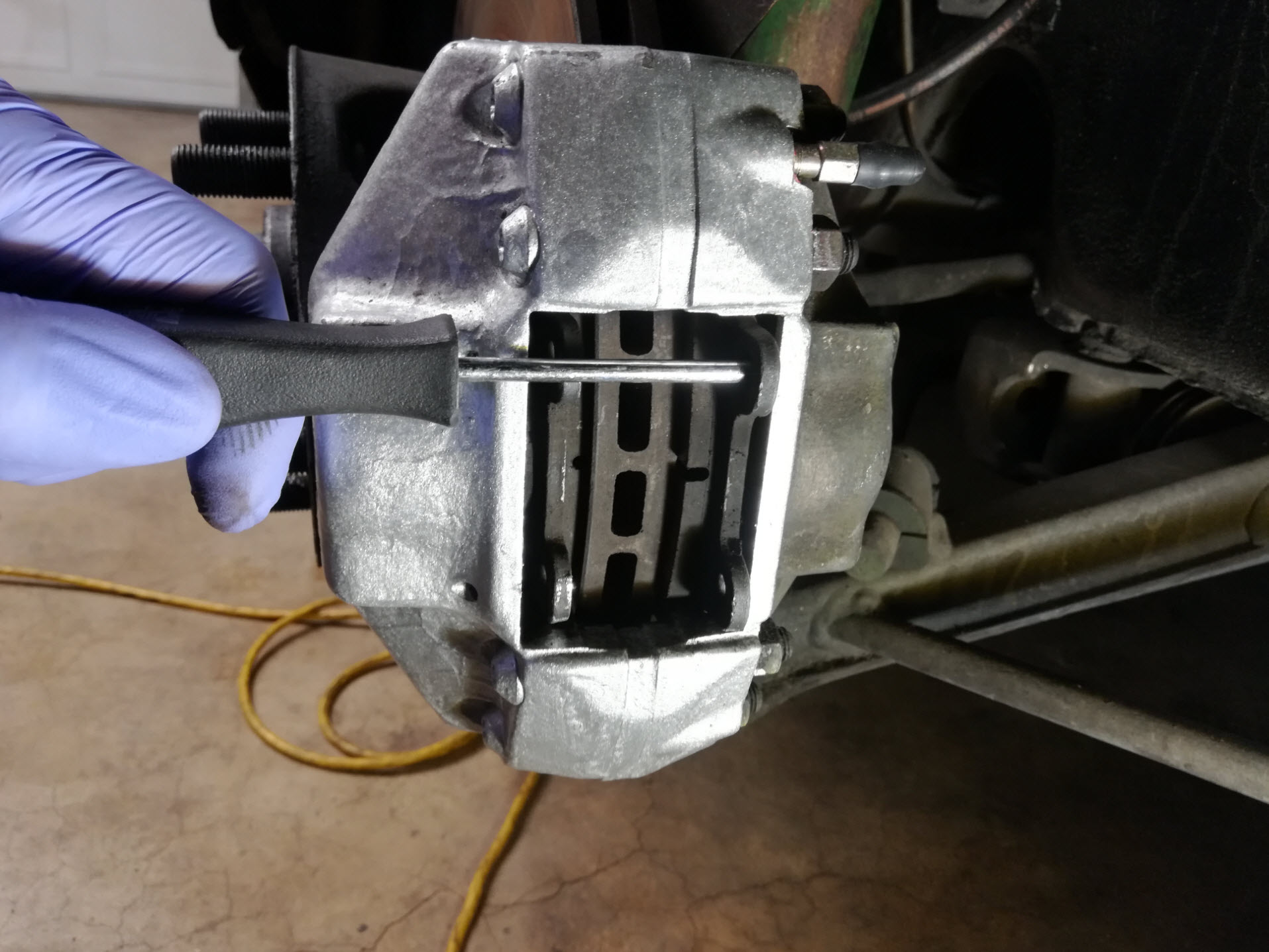 Air-cooled Porsche 911 brake pad removal tip.