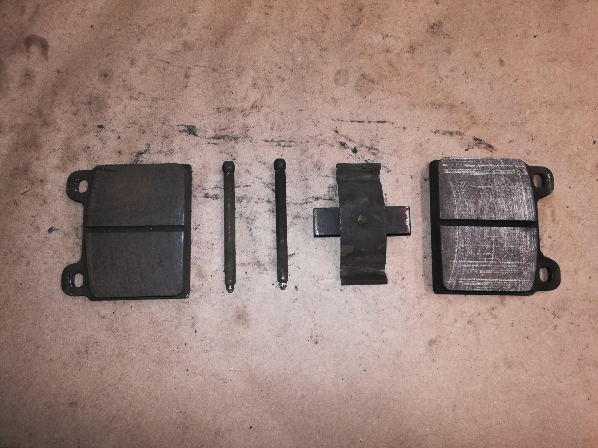 Air-cooled Porsche 911 brake pads and retaining hardware.