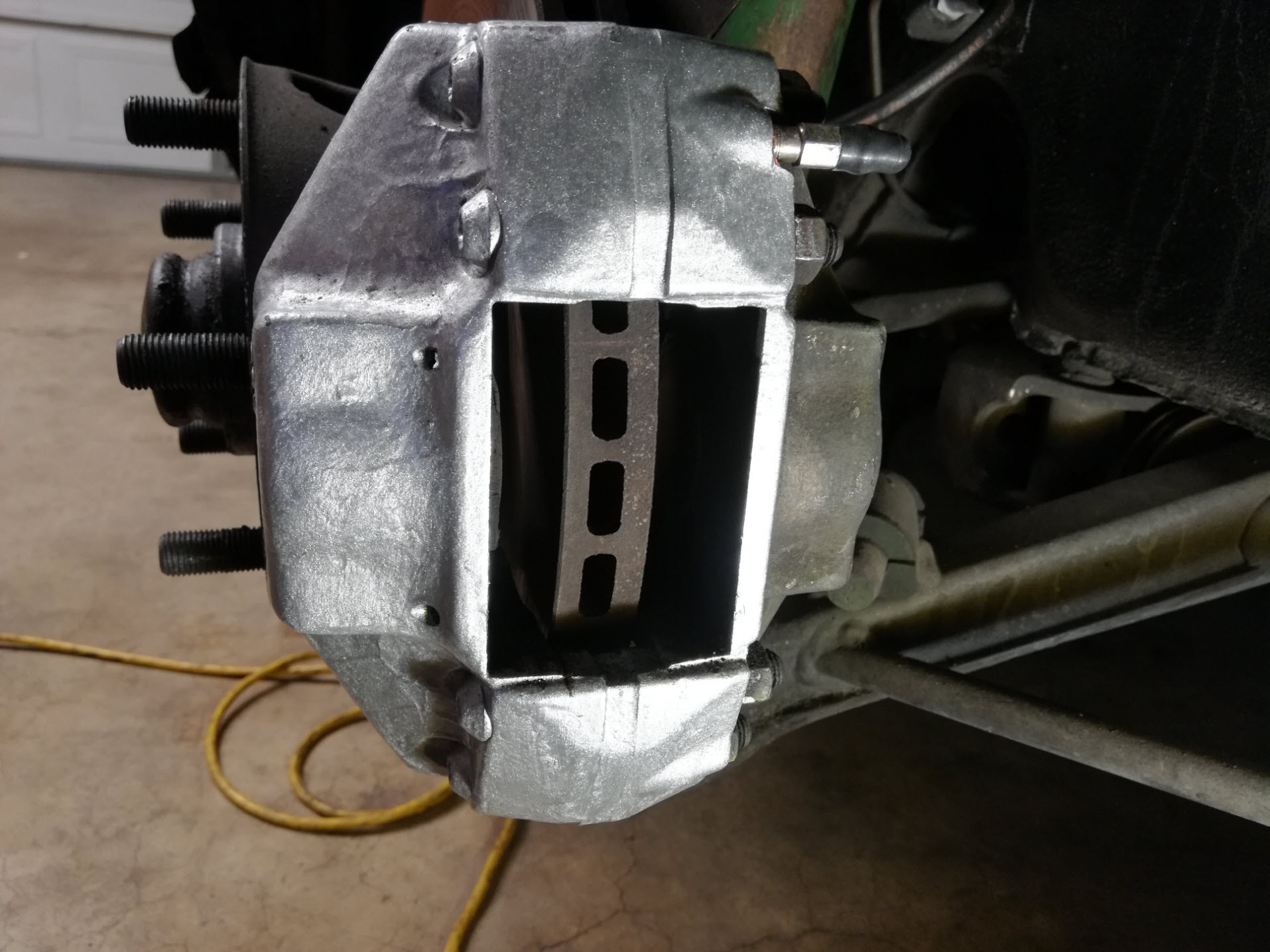 Air-cooled Porsche 911 brake caliper with no pads.