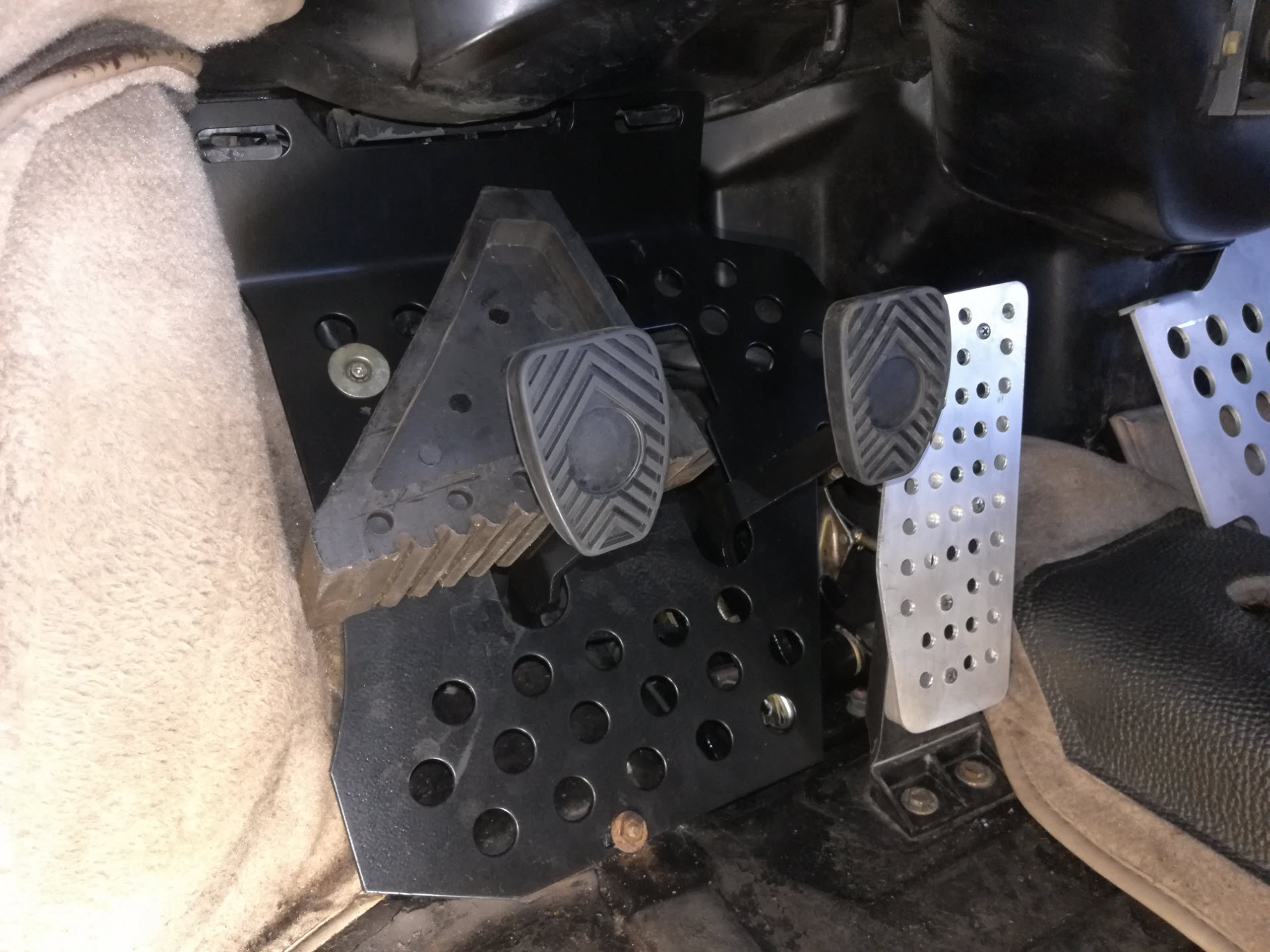 Air-cooled Porsche 911 clutch pedal chock for extra cable slack.