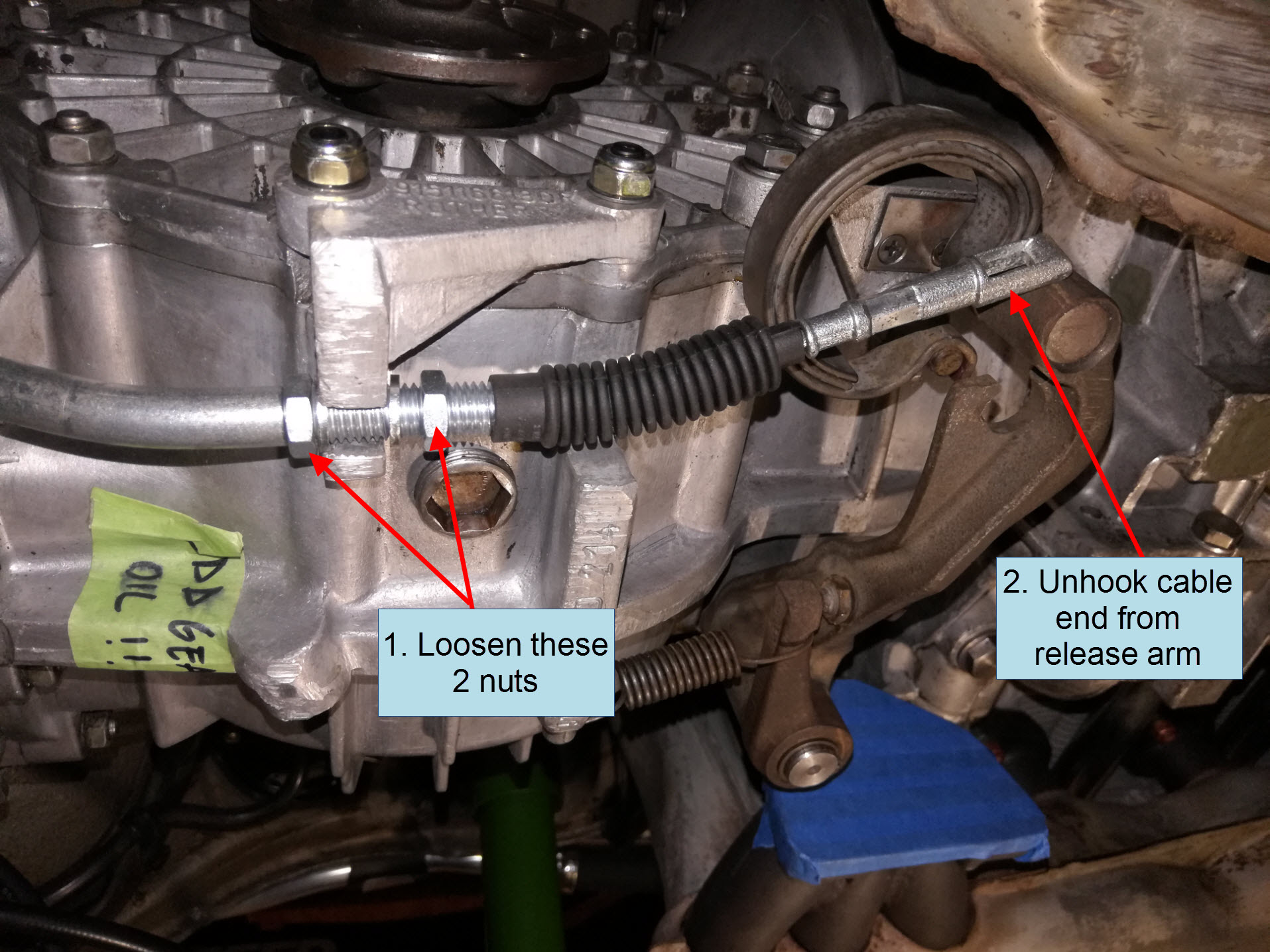 Air-cooled Porsche 911 clutch cable removal at gearbox.