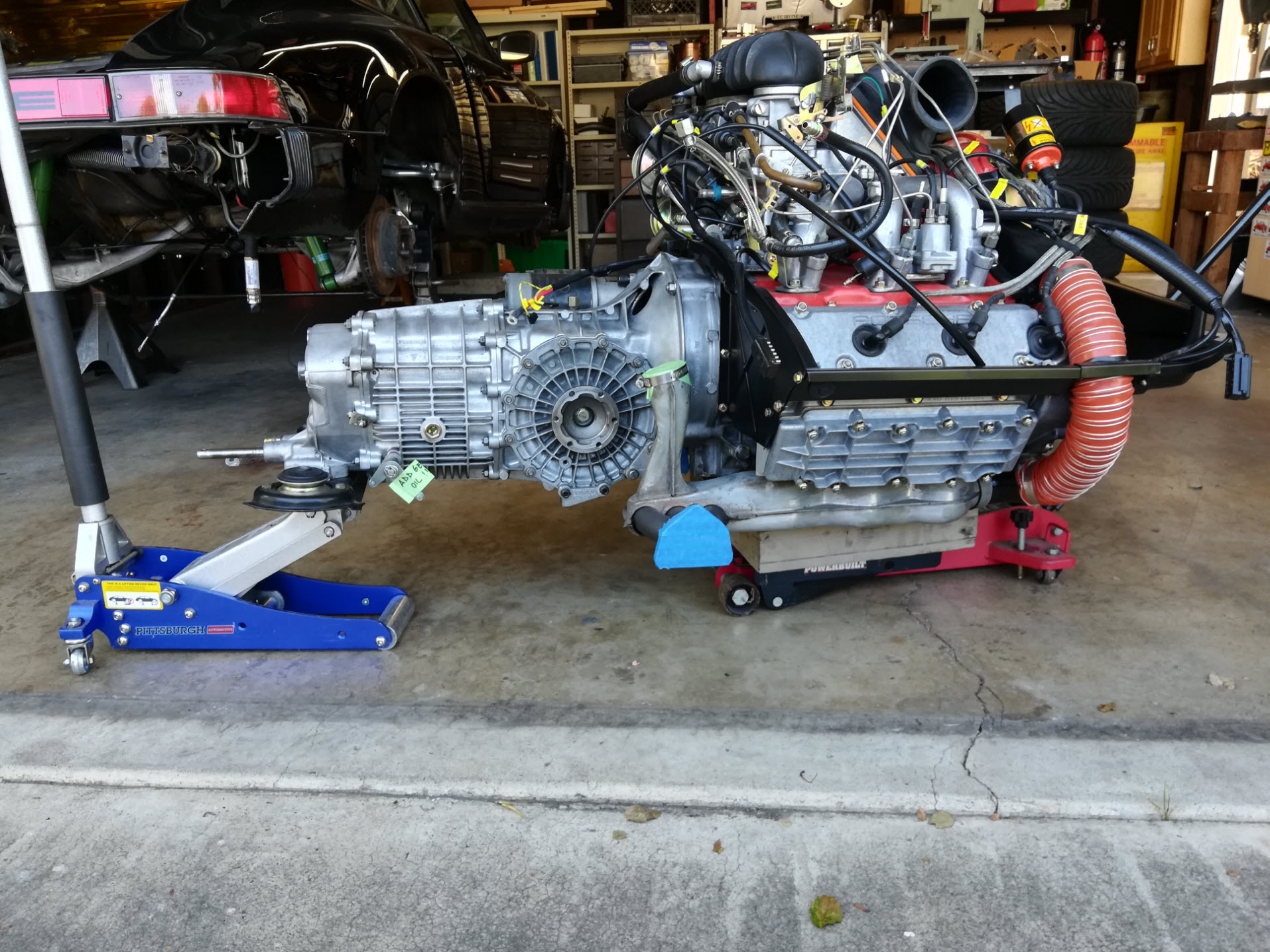 Air-cooled Porsche 911 engine and gearbox out of the car.