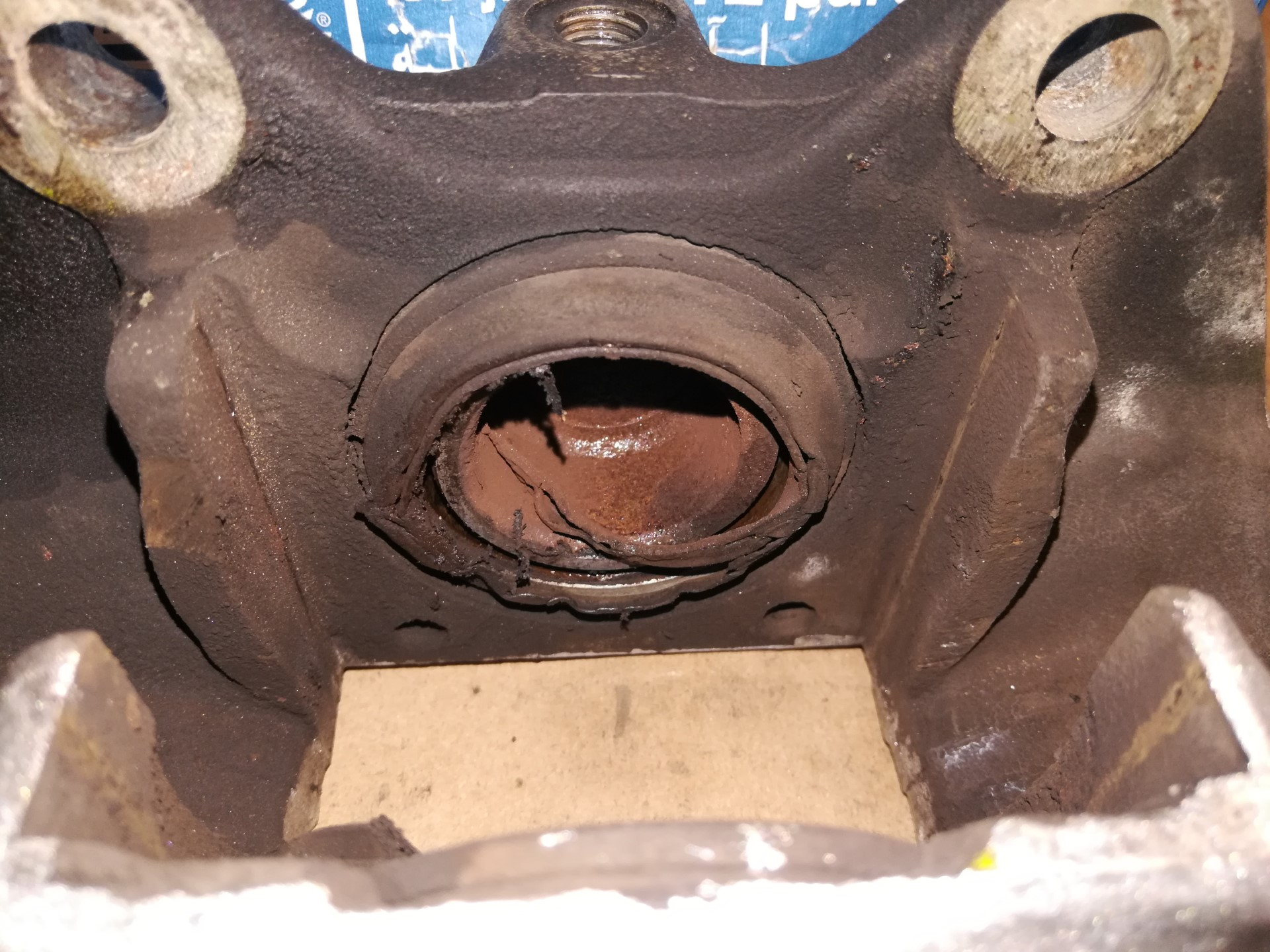 Air-cooled Porsche 911 front caliper piston seal damage