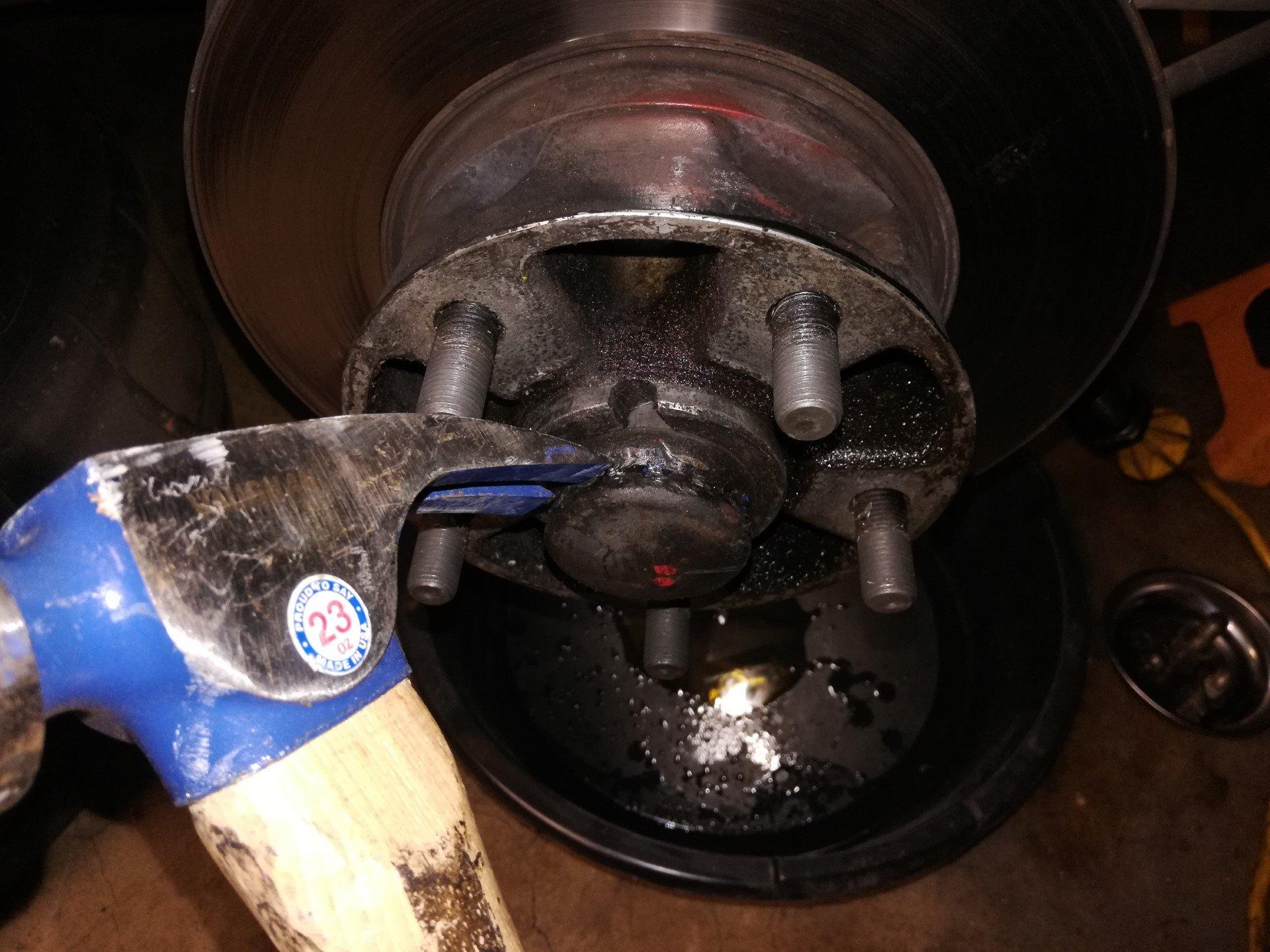 Air-cooled Porsche 911 front wheel hub dust cap removal