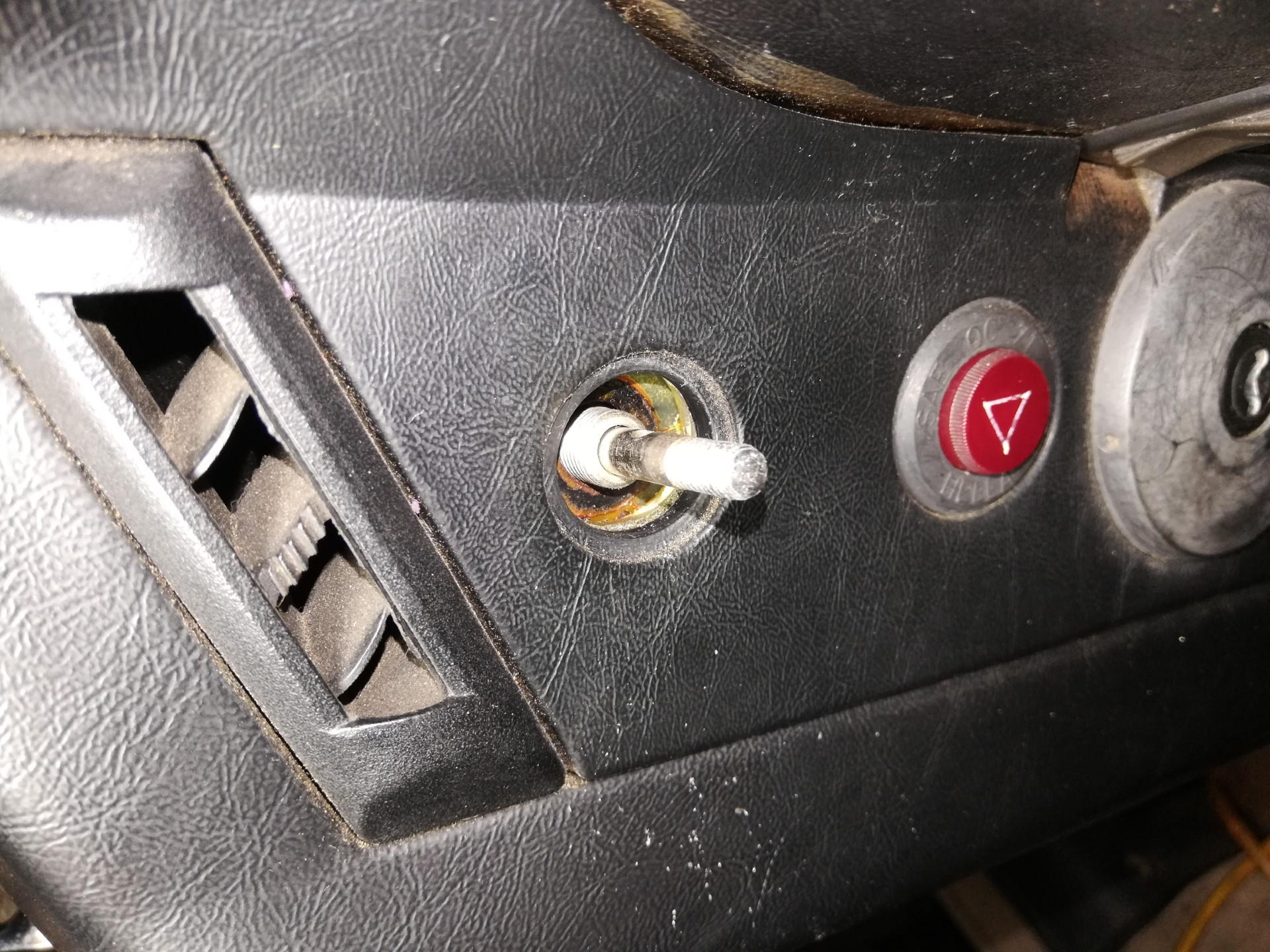 Air-cooled Porsche 911 headlight switch removal.