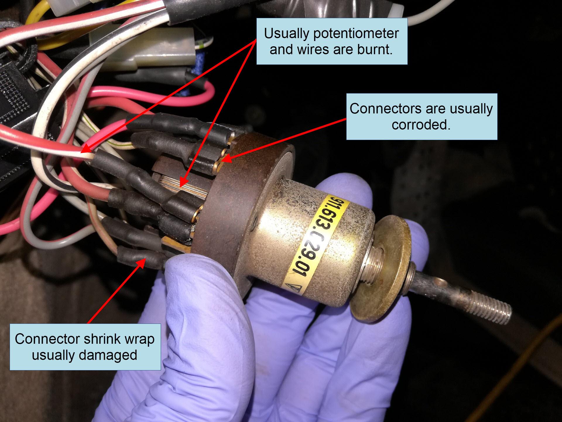 Air-cooled Porsche 911 headlight switch inspection.