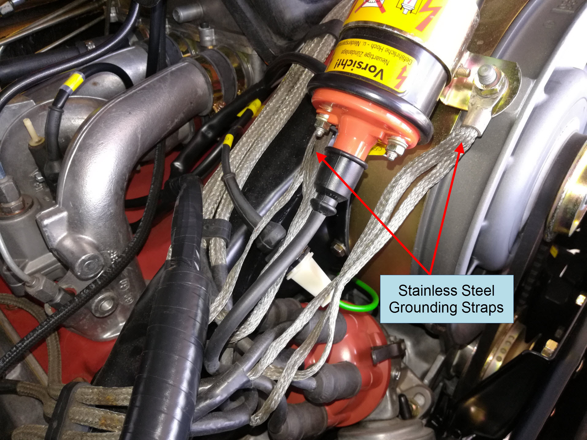 Air-cooled Porsche 911 spark plug wire stainless steel grounding straps.