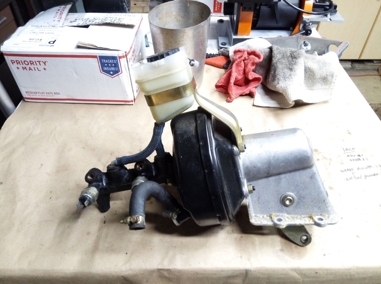 Air-cooled Porsche 911 master cylinder booster assembly.