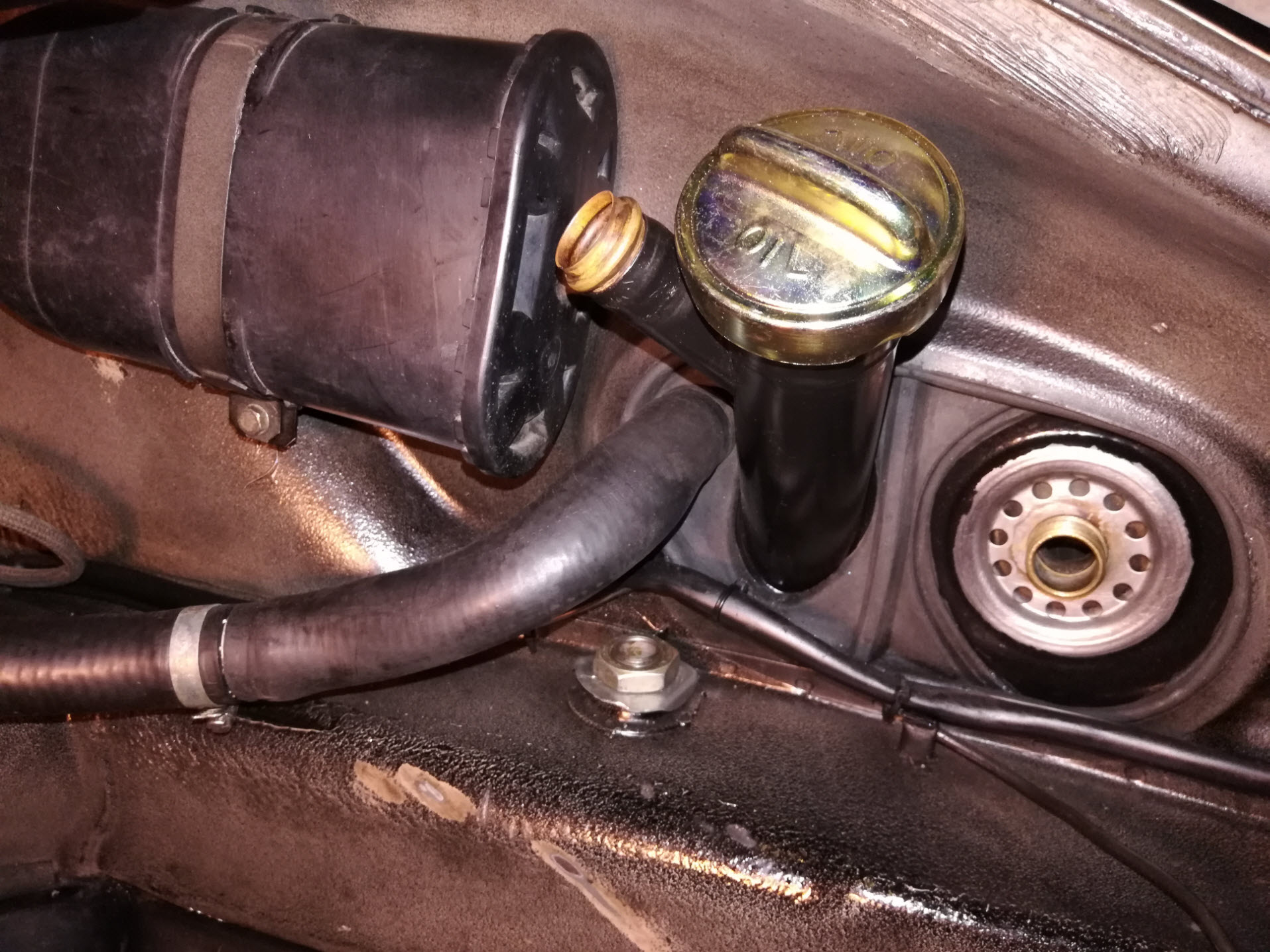 Porsche 911 oil breather restrictor re-install.