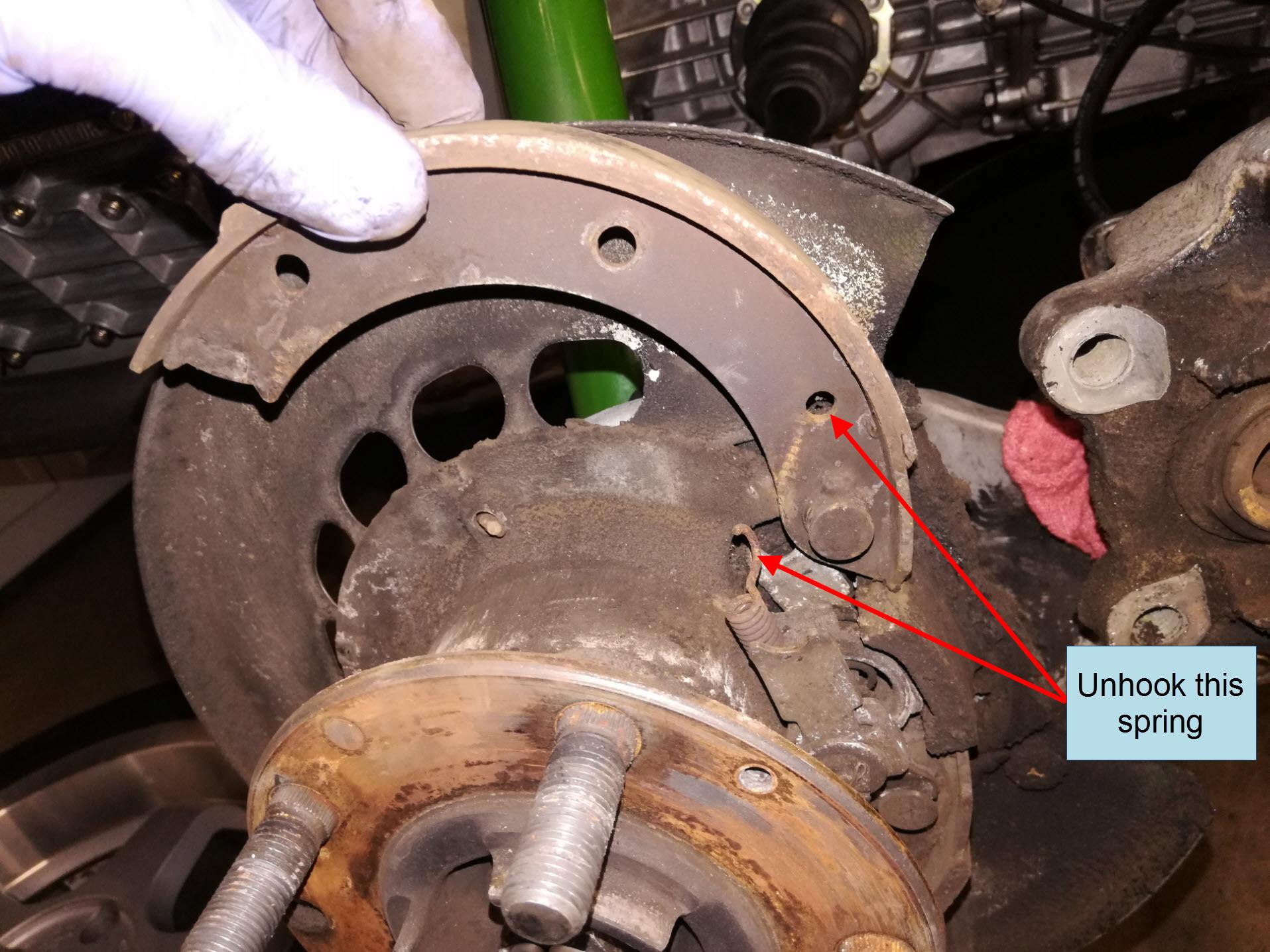 Air-cooled Porsche 911 parking brake shoe removal.