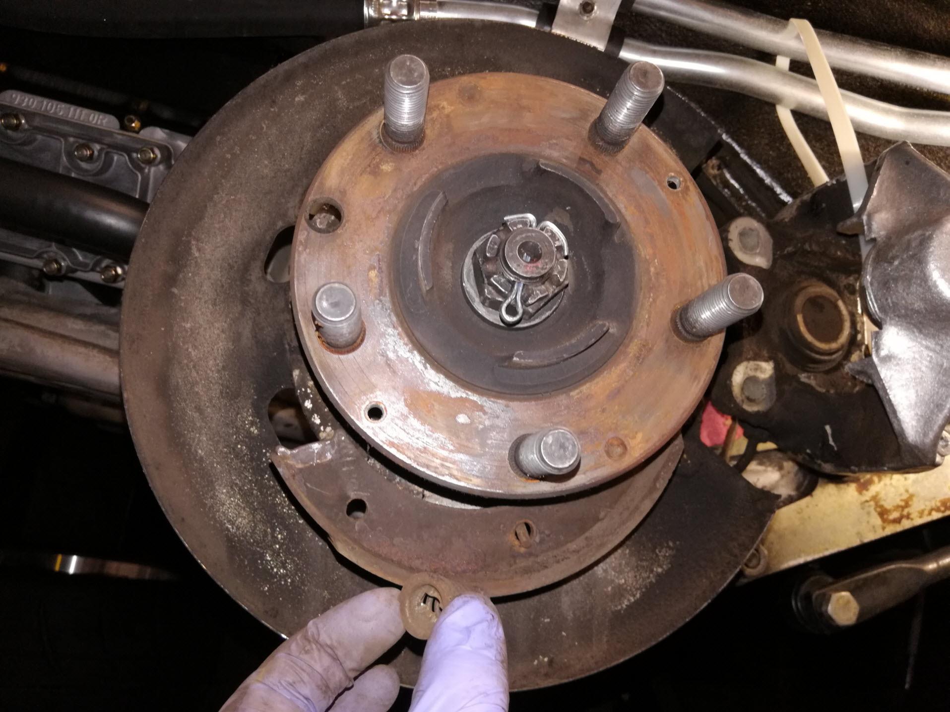 Air-cooled Porsche 911 parking brake spring removal.