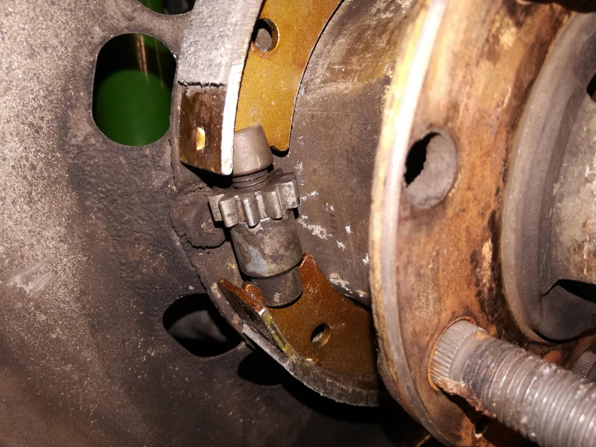 Air-cooled Porsche 911 parking brake adjuster reassembly.