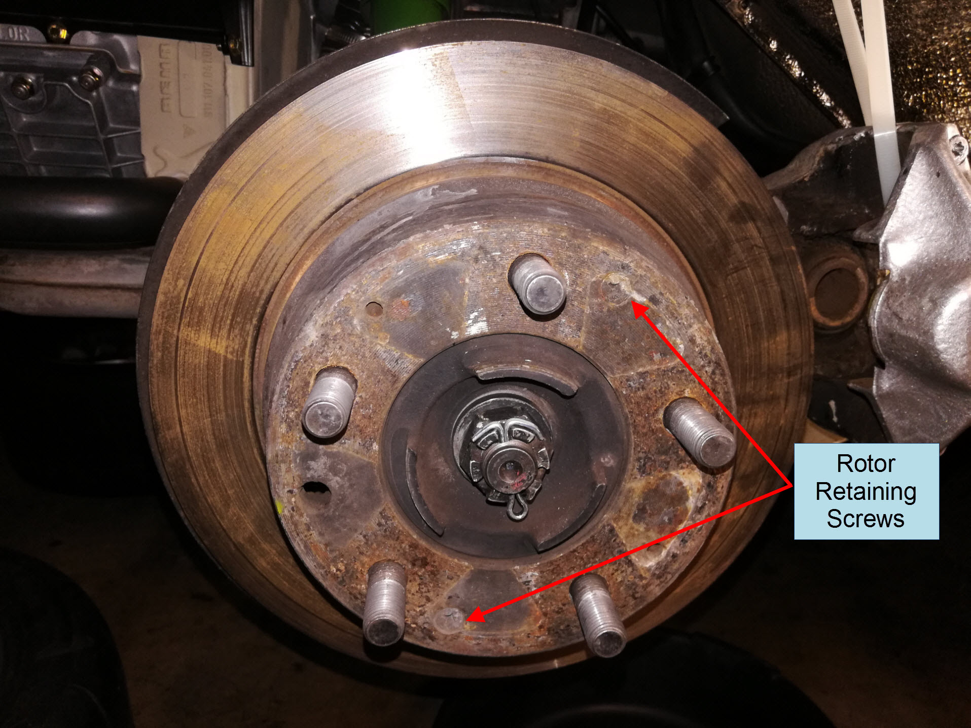 Air-cooled Porsche 911 rear brake rotor removal.