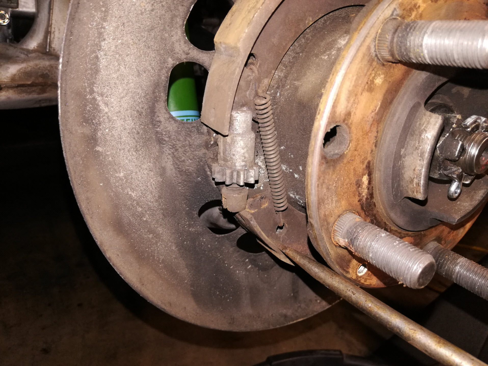 Air-cooled Porsche 911 parking brake adjuster removal.