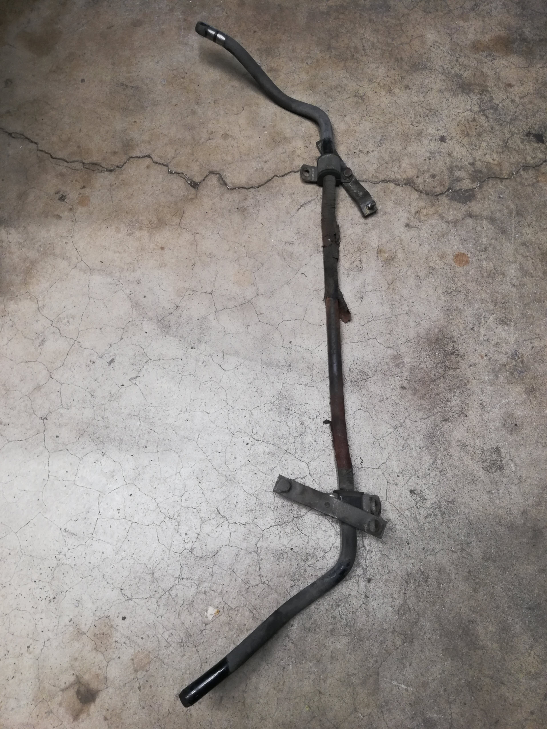 Air-cooled Porsche 911 front swaybar removed.